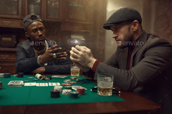 Poker player puts his wristwatch on the bank - Stock Photo - Images