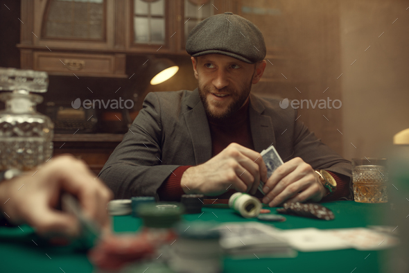 Professional poker player feels the risk, casino - Stock Photo - Images