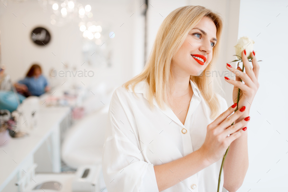 Woman holds rose, focus on manicure and flower - Stock Photo - Images
