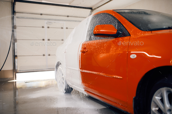 Automobile is half in foam, car wash service - Stock Photo - Images