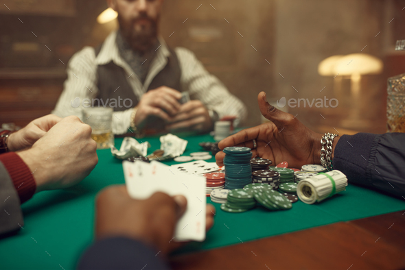 Male poker players at gaming table, casino - Stock Photo - Images