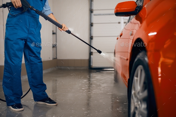 Female washer with high pressure gun, car wash - Stock Photo - Images