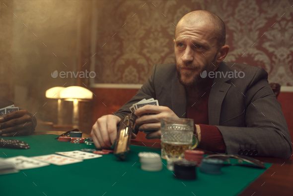 Poker player with gun plays in casino, risk - Stock Photo - Images