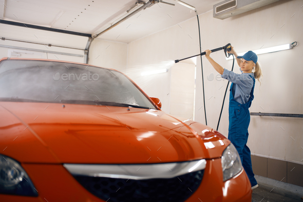 Washer with high pressure gun, car wash service - Stock Photo - Images