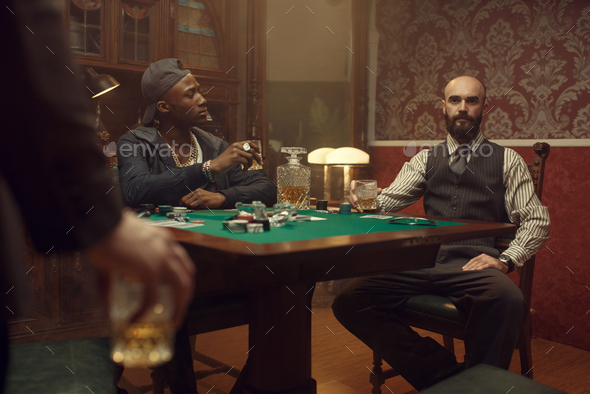 Three poker players with whiskey and cigars - Stock Photo - Images