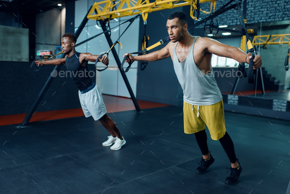 Two athletes at stretching exercise machine - Stock Photo - Images