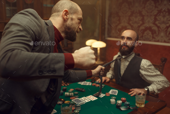 Poker player caught the sharper in casino - Stock Photo - Images