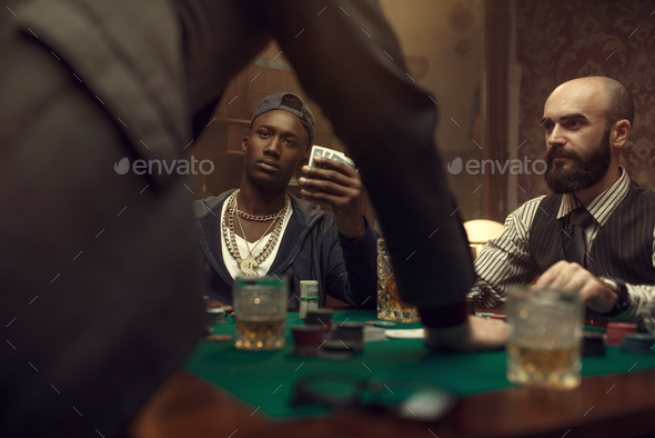 Three poker players in casino, blackjack - Stock Photo - Images