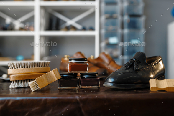 Shoe repair service concept, boots and polish - Stock Photo - Images