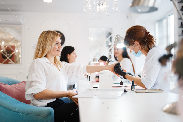 Group of girlfriends, manicure in beauty salon - Stock Photo - Images