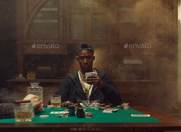 Poker player plays in casino - Stock Photo - Images