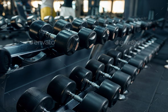 Row of dumbbells in gym closeup, nobody - Stock Photo - Images