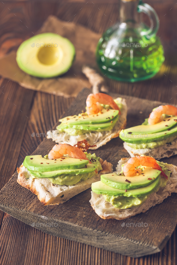 Sandwiches with avocado and shrimps - Stock Photo - Images