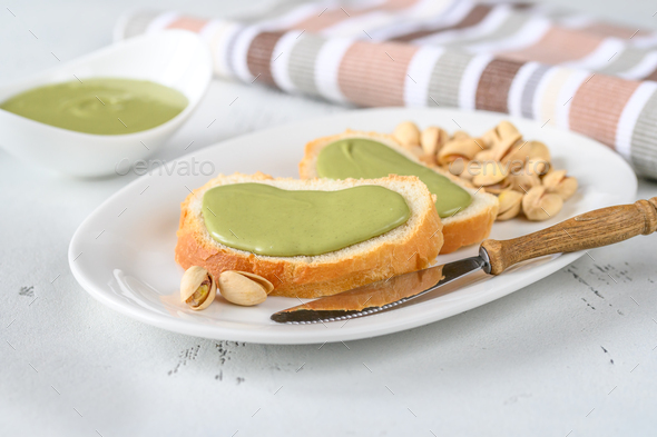 Baguette with pistachio butter - Stock Photo - Images