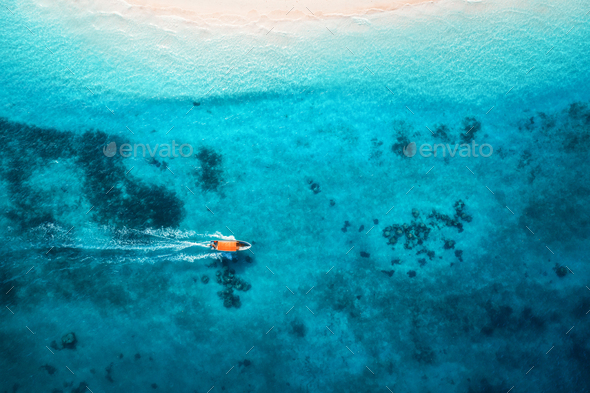 Aerial view of the fishing boats in clear blue water - Stock Photo - Images