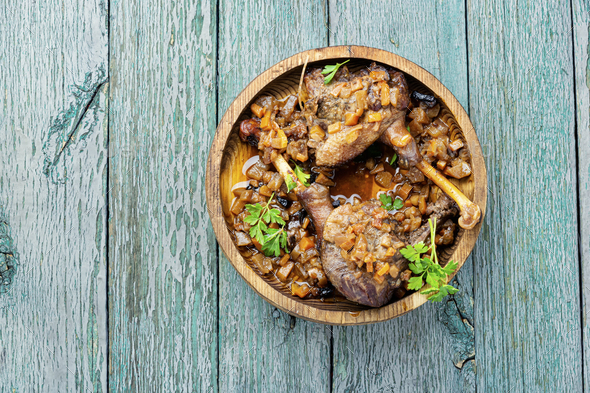 Baked duck leg - Stock Photo - Images