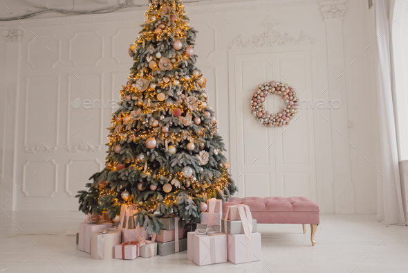 Christmas tree and sofa with gifts - Stock Photo - Images