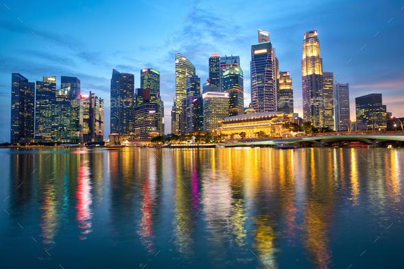 Singapore skyline at dusk - Stock Photo - Images