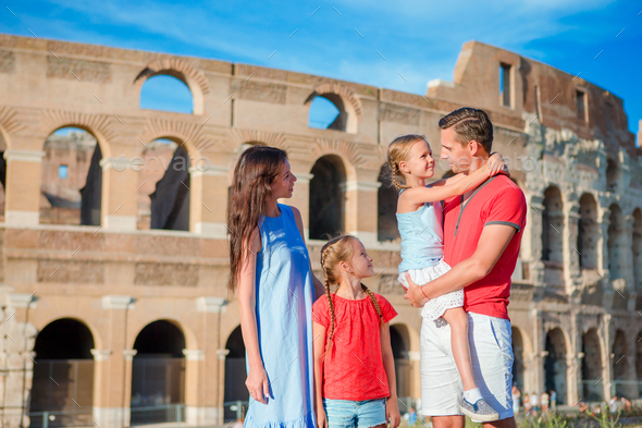 Happy family of four at italian vacation on Colosseum background in Rome - Stock Photo - Images