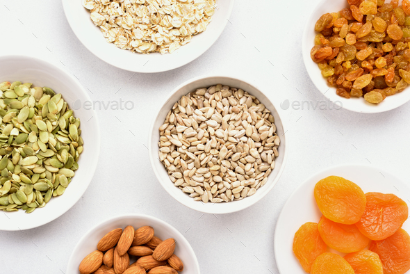 Bowl with ingredients for cooking granola - Stock Photo - Images