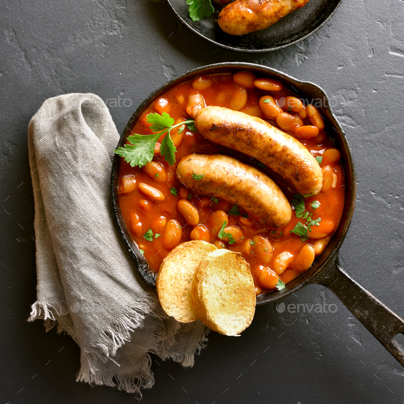 Sausages with baked white beans in tomato sauce - Stock Photo - Images