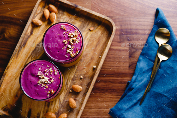 Top view of two glasses with violet berry smoothie - Stock Photo - Images