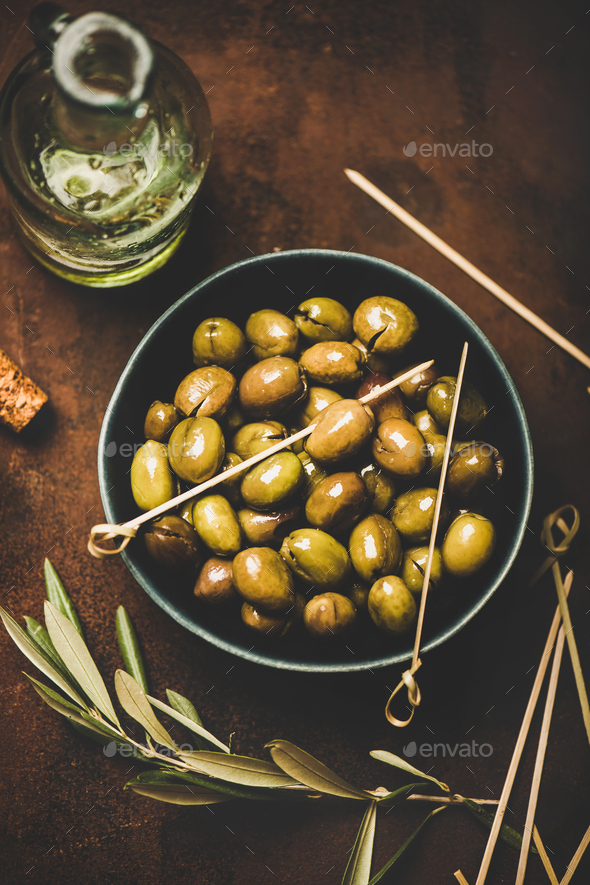 Flat-lay of fresh harvested seasonal pickled green Mediterranean olives - Stock Photo - Images