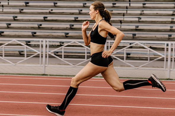 girl athlete running - Stock Photo - Images