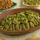 Moroccan meal with Cardoon, stuffed artichoke hearts with green peas and broad beans - PhotoDune Item for Sale