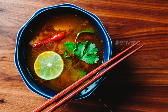 Top view of Thai vegetarian Tom Yum soup with mushrooms - Stock Photo - Images