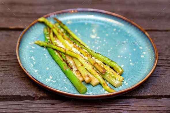 Close up delicious grilled asparagus on plate - Stock Photo - Images