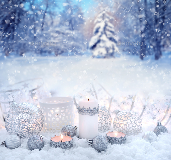 Christmas decorative balls and candles on snow on a background the winter forest - Stock Photo - Images
