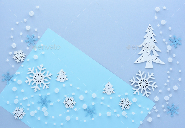Snowflakes, spruce and beads on pastel blue background. - Stock Photo - Images