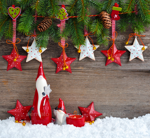 Christmas stars with gnomes and  branches of spruce on wooden background - Stock Photo - Images
