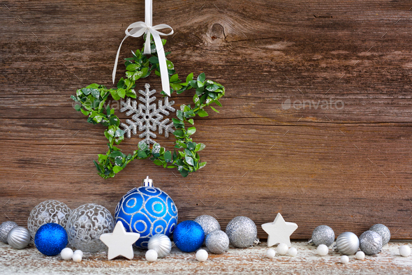 Christmas star with christmas balls on wooden background. Christmas or New Year greeting card. - Stock Photo - Images