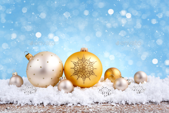 Christmas composition with festive decorative balls on the snow. New Year greeting card. - Stock Photo - Images