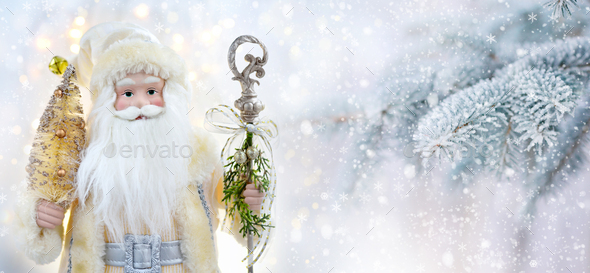 Happy Santa Doll on a background snow-covered fir branches. Christmas or New Year greeting card. - Stock Photo - Images