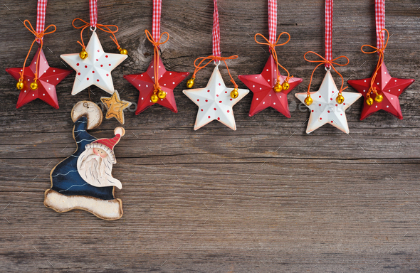 Santa Claus with Christmas stars decorations on wooden background - Stock Photo - Images