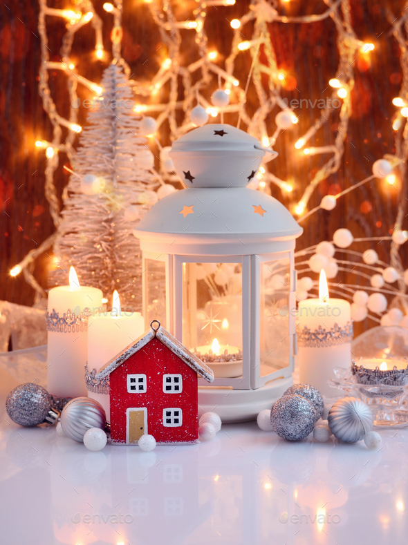 Christmas composition with lantern, candles and festive decorations - Stock Photo - Images