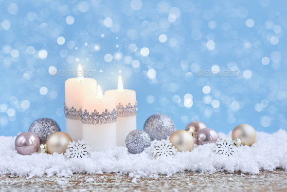 Christmas composition with candles and festive decorative balls on the snow. New Year greeting card. - Stock Photo - Images
