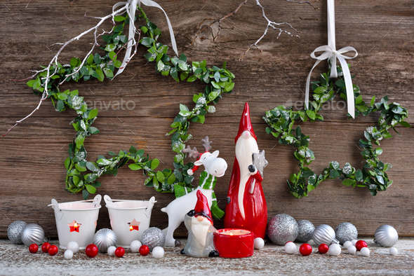 Christmas composition with gnomes, elk figurine and festive decorations on wooden background - Stock Photo - Images