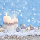 Christmas composition with candles and festive decorative balls on the snow. New Year greeting card. - PhotoDune Item for Sale