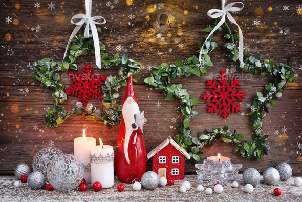 Christmas composition with candles, gnome figurine, photo frame and festive decorations - Stock Photo - Images