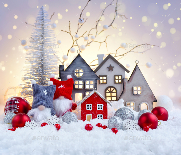 Christmas composition with gnomes, huts and festive decorations on the snow - Stock Photo - Images
