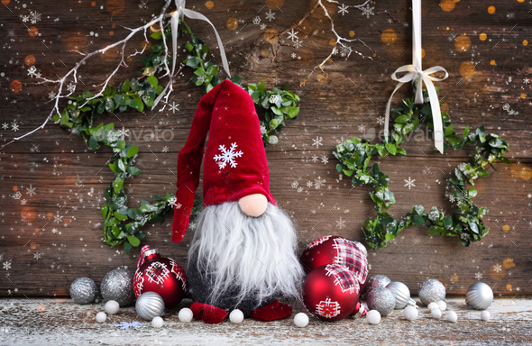 Christmas composition with gnome and festive decorations on wooden background - Stock Photo - Images