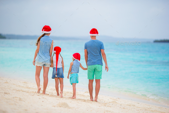 Happy family during tropical Christmas vacation - Stock Photo - Images