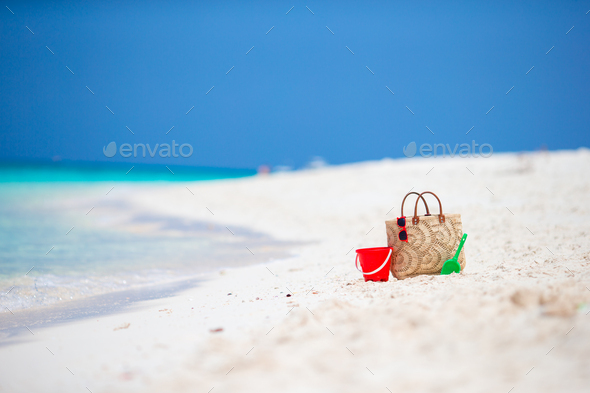 Beach accessories - straw bag, headphones, beach kids toys and sunglasses on the beach - Stock Photo - Images