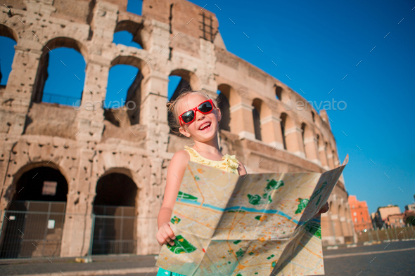 Adorable little active girl with map in front of Colosseum in Rome, Italy. Kid spending childhood in - Stock Photo - Images