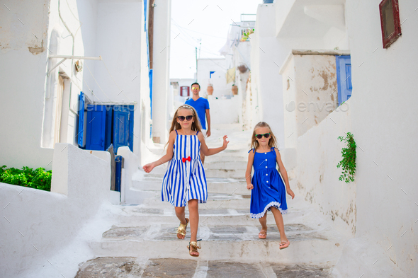 Family vacation in Europe. Father and kids at street of typical greek traditional village on Mykonos - Stock Photo - Images