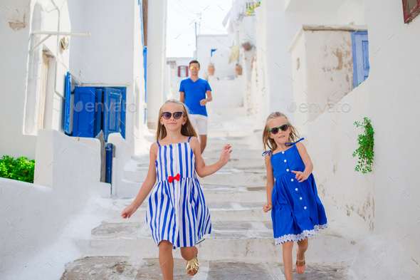 Family vacation in Europe. Father and kids at narrow street on Mykonos Island, in Greece - Stock Photo - Images